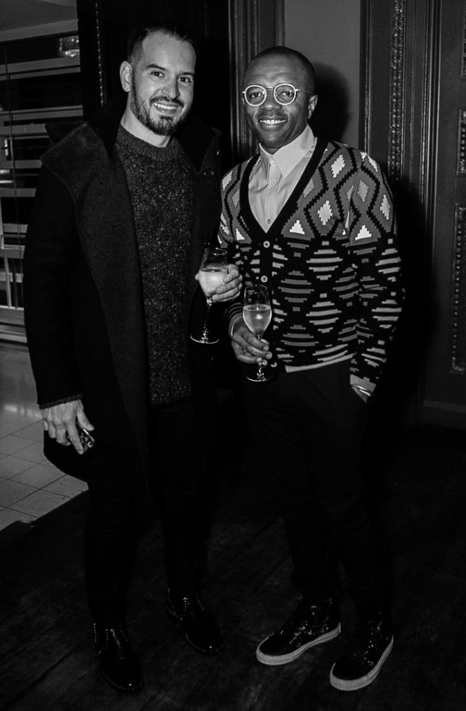 James Kahuri and guest at the Sagaboi drinks party during LFWM held at the Andaz Hotel, Liverpool Street.