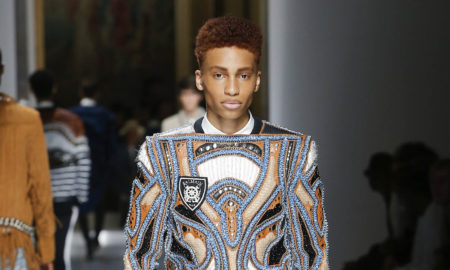 Black male model walking the catwalk at Balmain SS18 men's fashion show at Paris Fashion Week (PFW/PMFW)