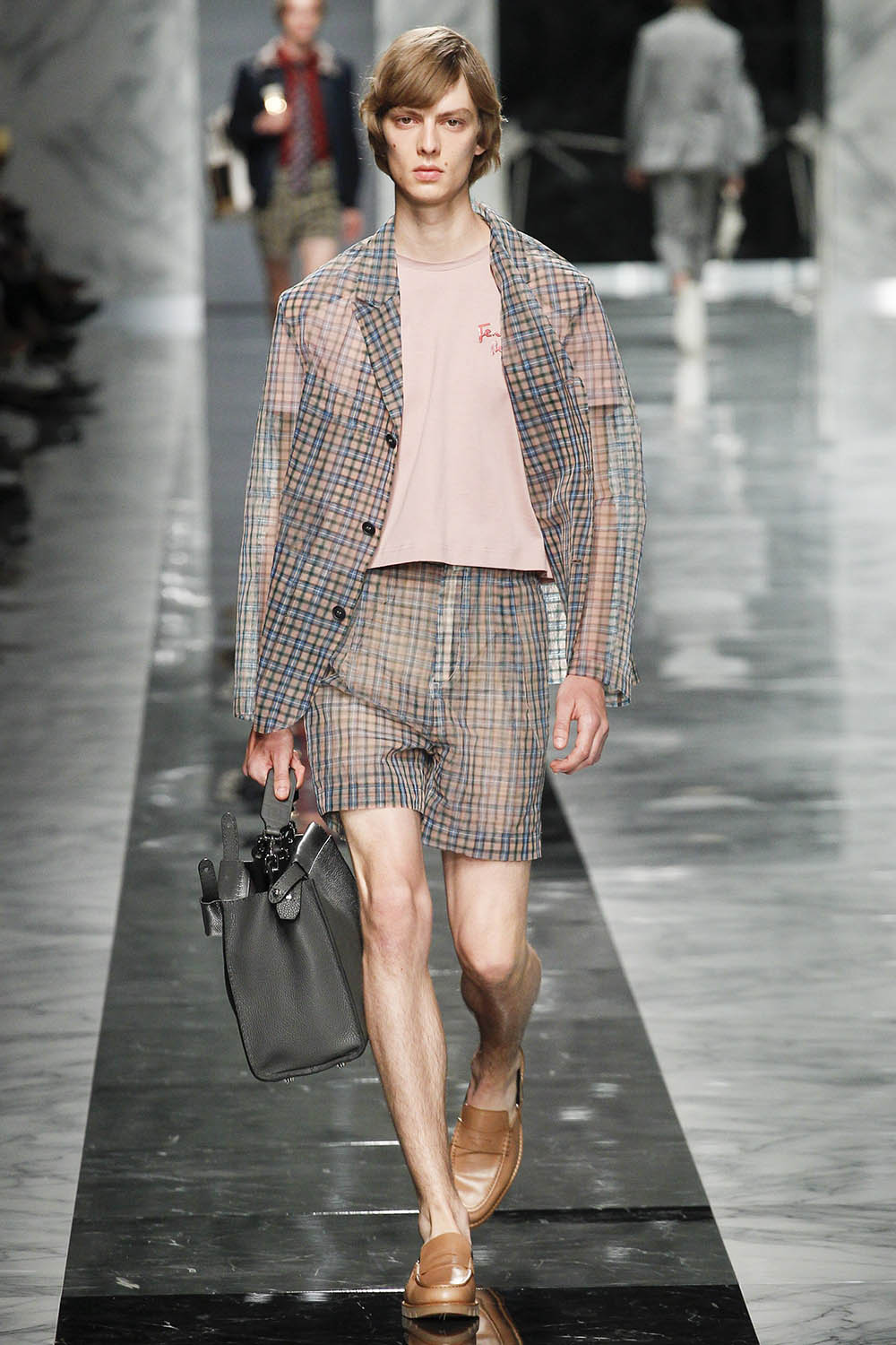 Model walking the catwalk at Fendi (by Karl Lagerfeld) SS18 men'