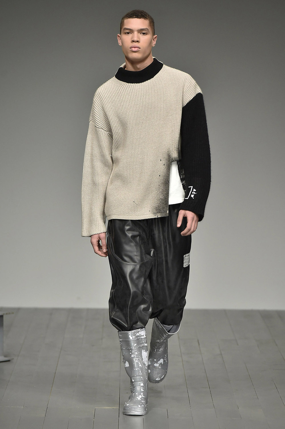 Male model walking the catwalk at A Cold Wall Fall Winter 18 men