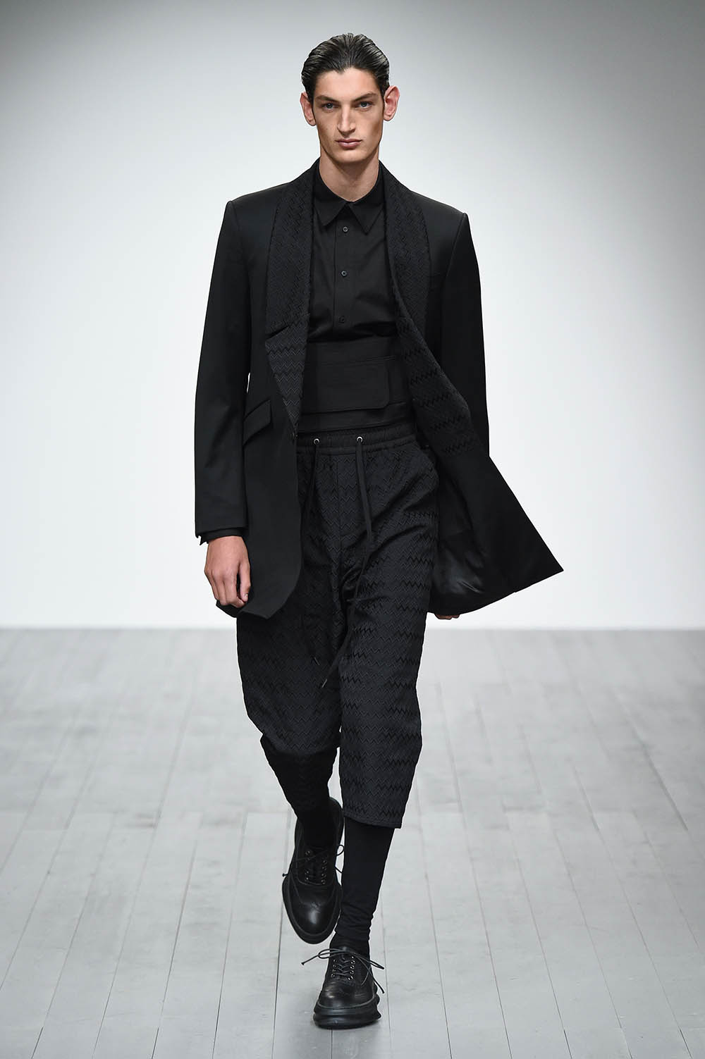 Male model walking the catwalk at D.Gnak Fall Winter 18 men's fa
