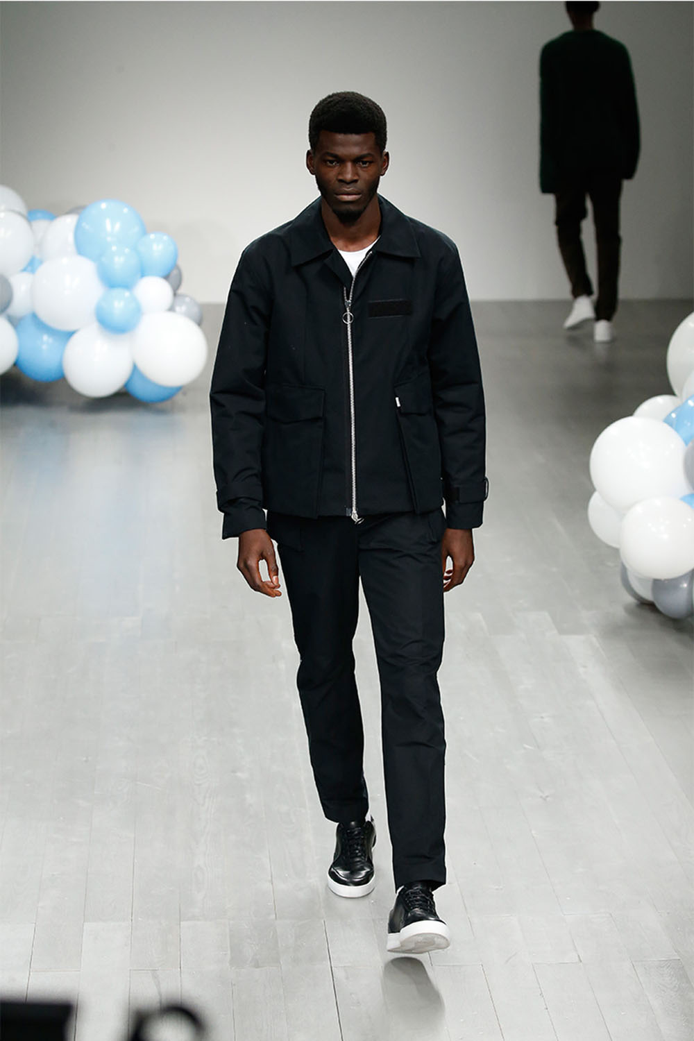 Male model walking the catwalk at (Tinie Tempah's) What We Wear