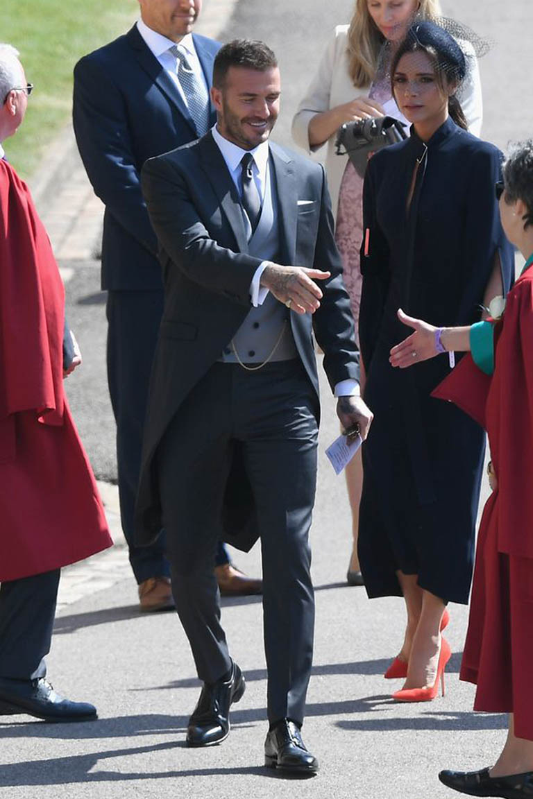 David Beckham (in Dior Homme by Kim Jones) and Victoria Beckham at the royal wedding of Prince Harry and Meghan Markle