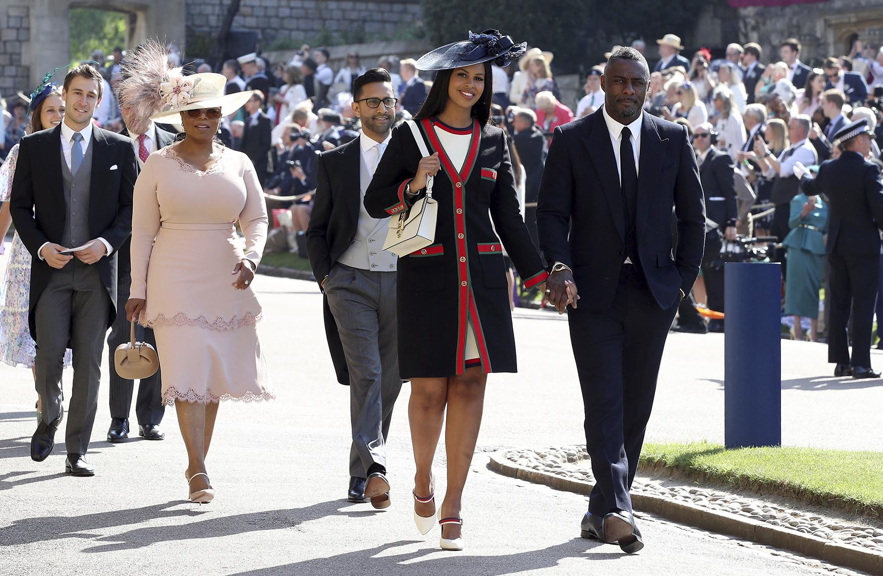 British actor Idris Elba, right, arrives with his fiancee Sabrina Dhowre, followed by Oprah Winfrey for the wedding ceremony of Prince Harry and Meghan Markle at St. George's Chapel in Windsor Castle in Windsor, near London, England, Saturday, May 19, 2018.