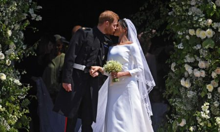 Meghan Markle and Prince Harry Royal Wedding of Prince Harry and Meghan Markle in Windsor, United Kingdom - 19 May 2018 Britain's Prince Harry (L) and Meghan Markle (R) kiss as they exit St George's Chapel in Windsor Castle after their royal wedding ceremony, in Windsor, Britain, 19 May 2018. The couple have been bestowed the royal titles of Duke and Duchess of Sussex on them by the British monarch.