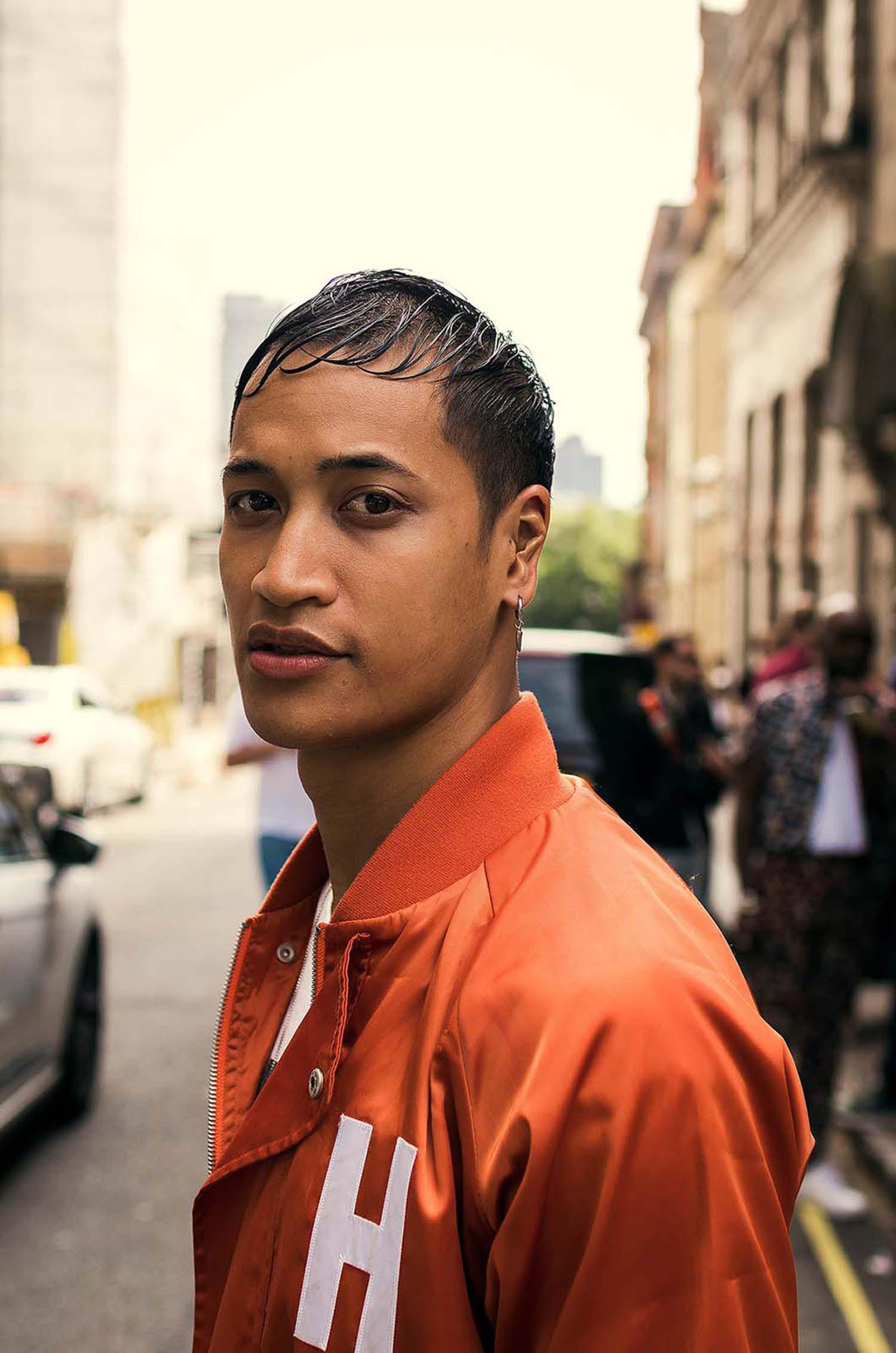 Male model captured outside the men's fashion shows at London Fashion Week Men's. (LFWM Street Style by Olajide (JJ) Smith (Spotted By Mr. Smith for Sagaboi. Diversity in Street Style. Representation in stock imagery.