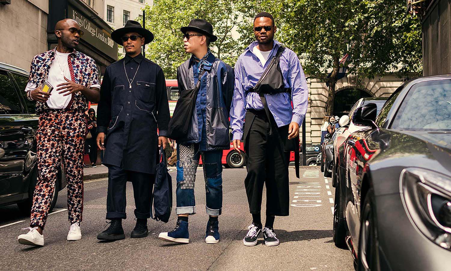 Geoff K. Cooper, Eshan Kali, John Jarret, and Kieron Watts captured outside the men's fashion shows at London Fashion Week Men's. (LFWM Street Style by Olajide (JJ) Smith (Spotted By Mr. Smith for Sagaboi. Diversity in Street Style. Representation in stock imagery.