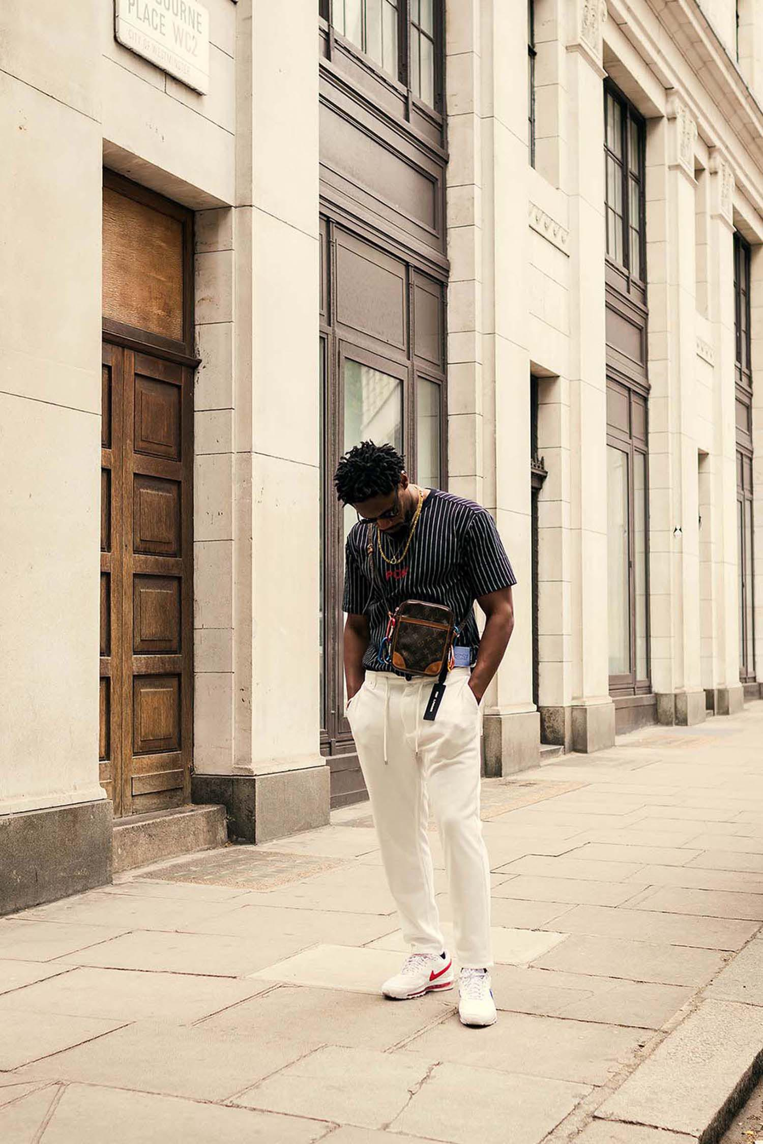 Diverse man captured outside the men's fashion shows at London Fashion Week Men's. (LFWM Street Style by Olajide (JJ) Smith (Spotted By Mr. Smith for Sagaboi. Diversity in Street Style. Representation in stock imagery.