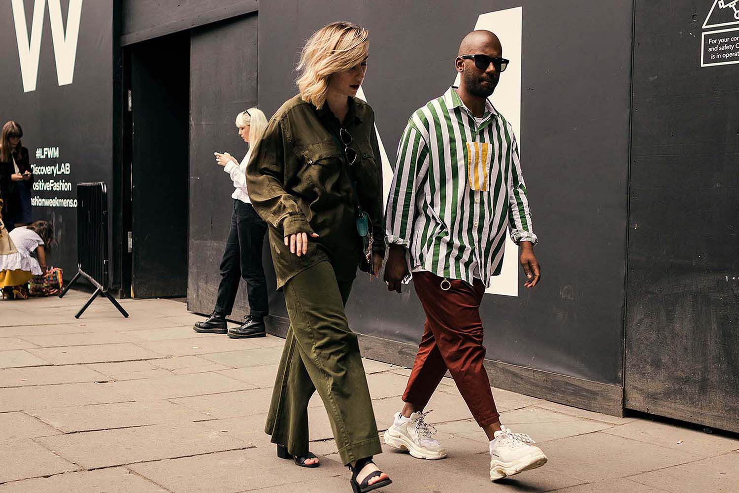 Stylish woman and man captured outside the men's fashion shows at London Fashion Week Men's. (LFWM Street Style by Olajide (JJ) Smith (Spotted By Mr. Smith for Sagaboi. Diversity in Street Style. Representation in stock imagery.