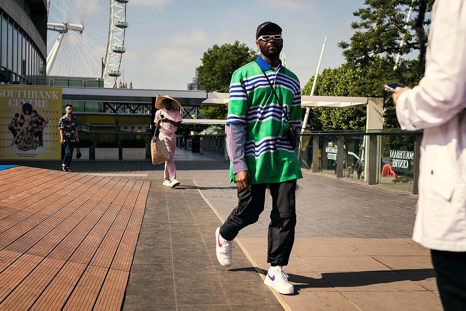 Terence Sambo captured outside the men's fashion shows at London Fashion Week Men's. (LFWM Street Style by Olajide (JJ) Smith (Spotted By Mr. Smith for Sagaboi. Diversity in Street Style. Representation in stock imagery.
