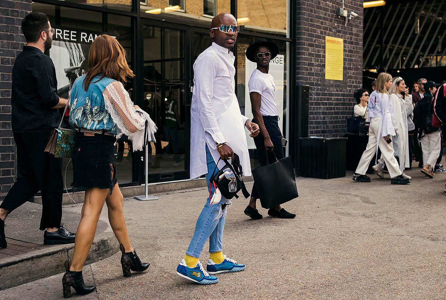 Geoff K. Cooper captured outside the men's fashion shows at London Fashion Week Men's. (LFWM Street Style by Olajide (JJ) Smith (Spotted By Mr. Smith for Sagaboi. Diversity in Street Style. Representation in stock imagery.