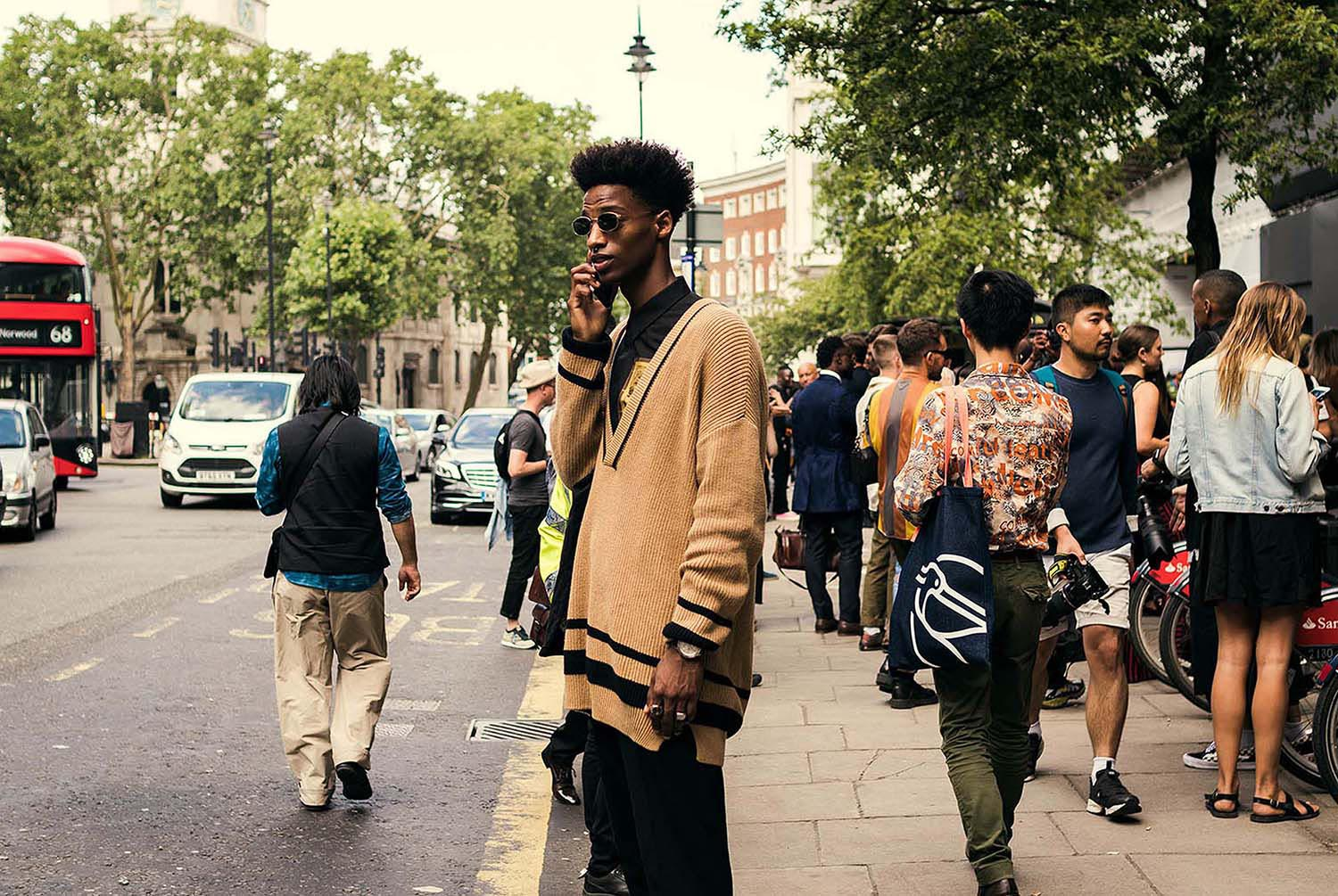 Stylish black man captured outside the men's fashion shows at London Fashion Week Men's. (LFWM Street Style by Olajide (JJ) Smith (Spotted By Mr. Smith for Sagaboi. Diversity in Street Style. Representation in stock imagery.