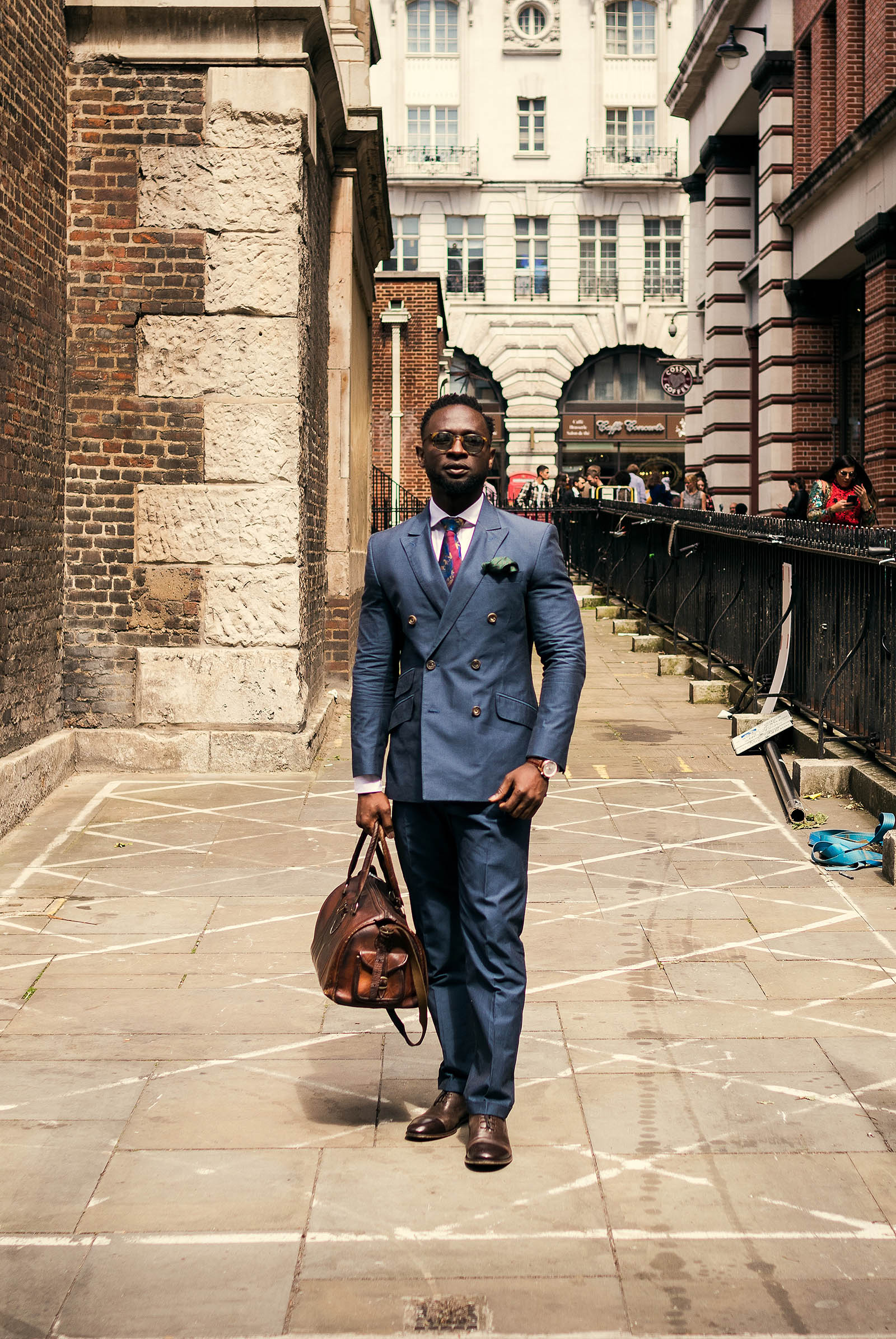 Edward Kamara (CutsForHim) captured outside the men's fashion shows at London Fashion Week Men's. (LFWM Street Style by Olajide (JJ) Smith (Spotted By Mr. Smith for Sagaboi. Diversity in Street Style. Representation in stock imagery.