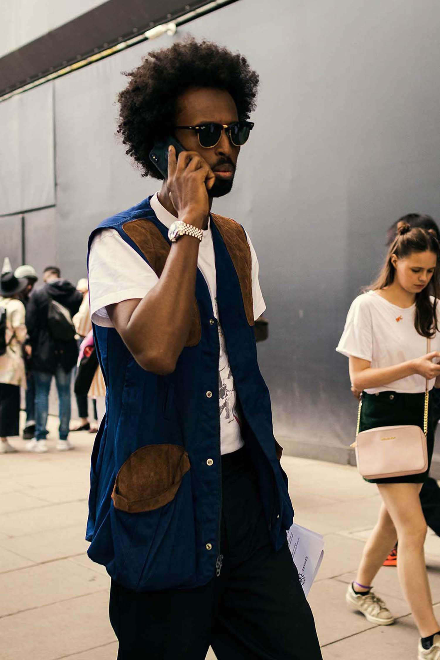 Liban Mohammed captured outside the men's fashion shows at London Fashion Week Men's. (LFWM Street Style by Olajide (JJ) Smith (Spotted By Mr. Smith for Sagaboi. Diversity in Street Style. Representation in stock imagery.